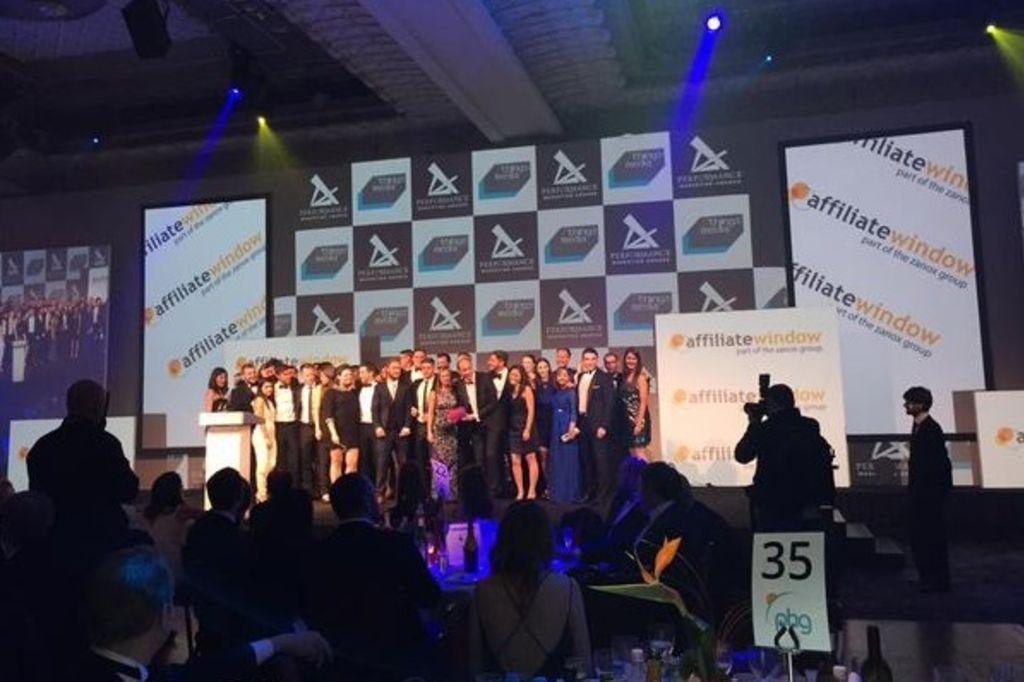 Performance marketing awards Awin collecting award