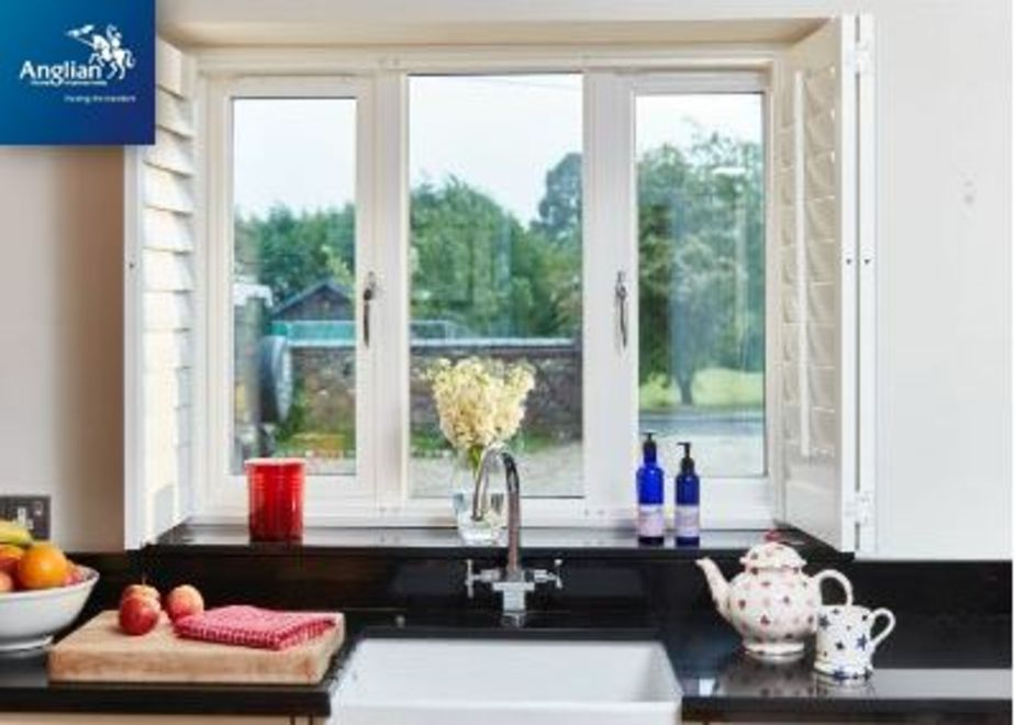 Anglian logo with campaign image of kitchen windows