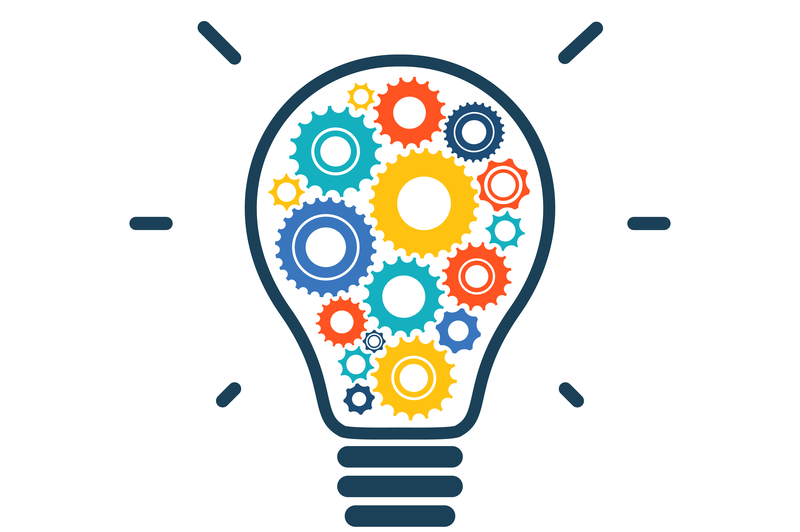 An image of a lightbulb filled with multicoloured cogs alluding to market insights.