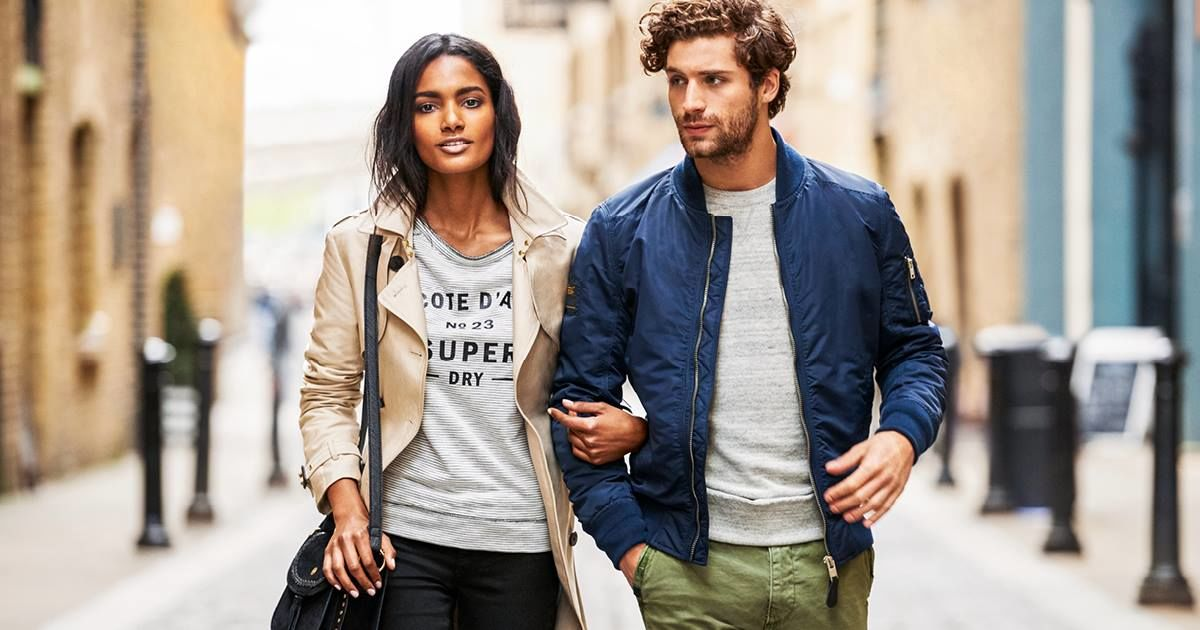 Man and Woman walking down street in Superdry clothing