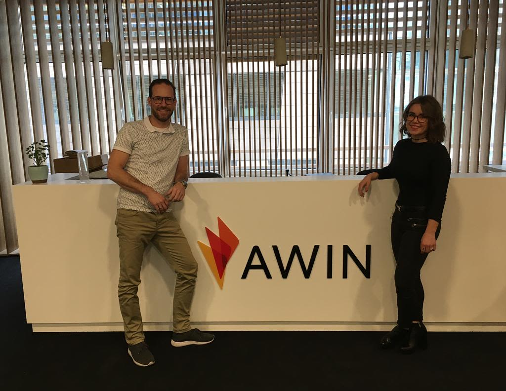 A photo of Fashiola CEO, Peter Langenkamp standing in front of the Awin HQ reception sign.