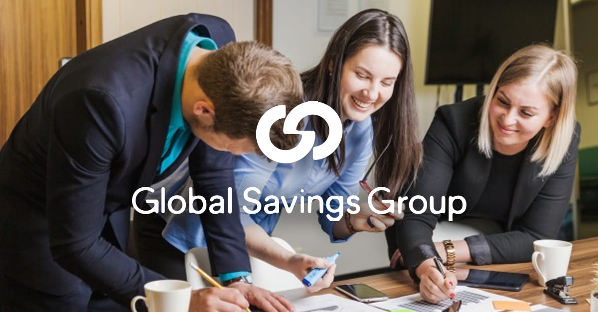 People sat a table drawing on a piece of paper with the Global Savings group logo overlaid on top.