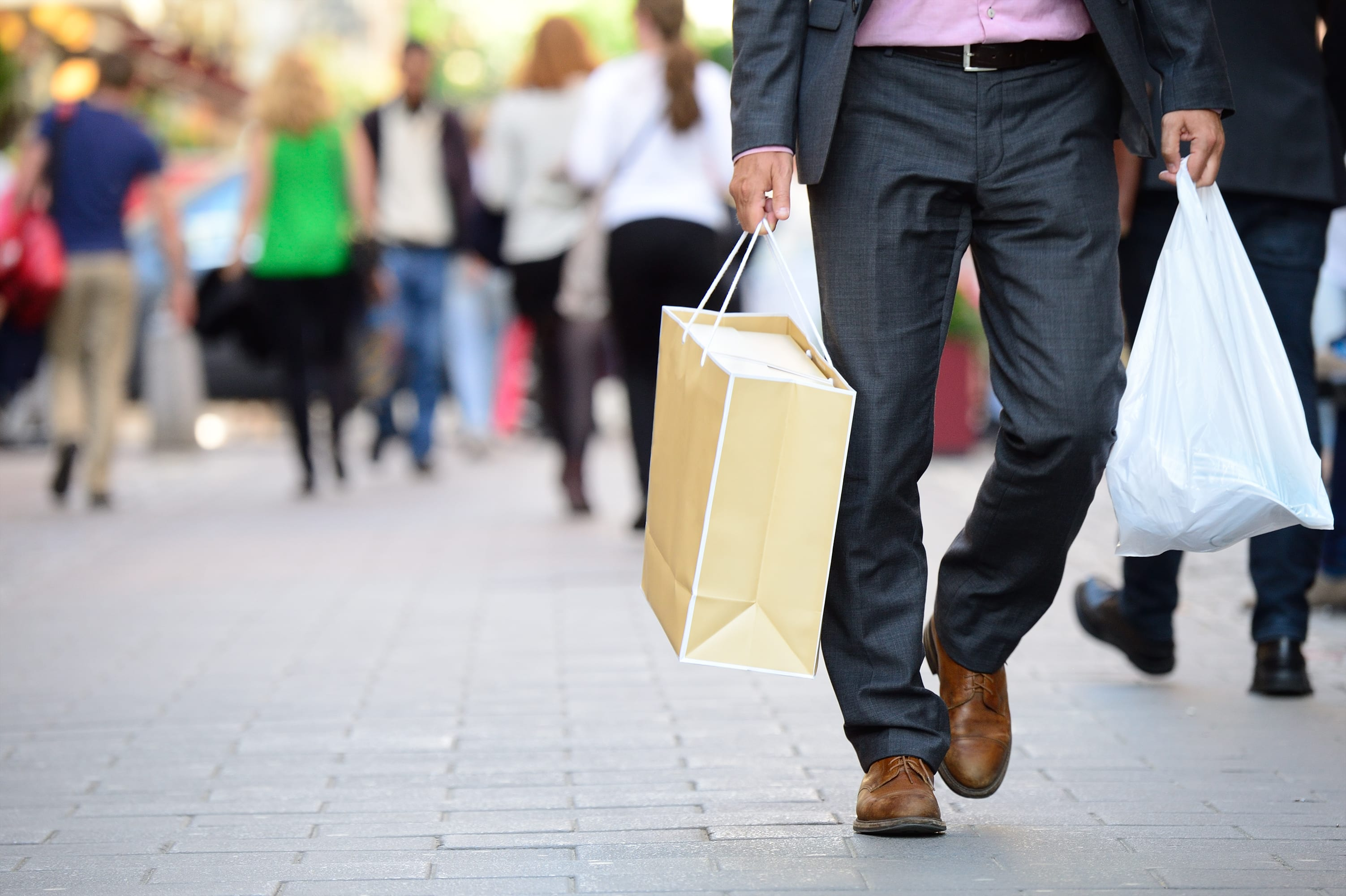 Man holding shopping bags affiliate singles day