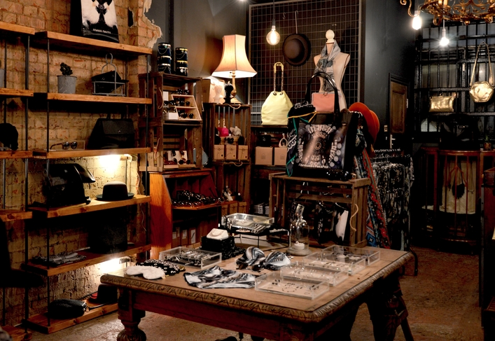 An image of a fashion store interior with a variety of garments and accessories neatly presented.
